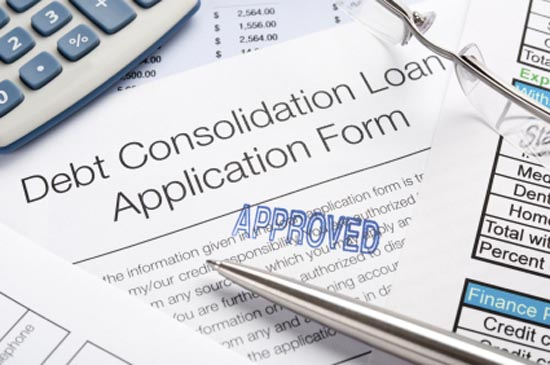 Approved Debt Consolidation Loan Application Form with pen, calc